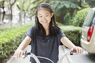 Young girl riding bike.